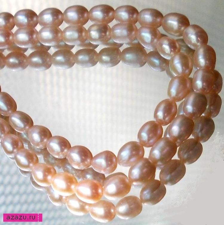 Натуральный жемчуг рис розовый длина 7 мм *11385 Прекрасный блеск, очень хорошая, совершенно гладкая и ровная поверхность жемчужины.